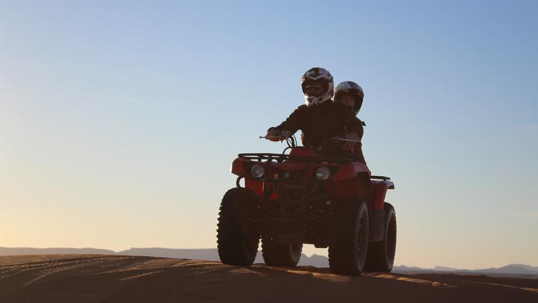Two people on ATV